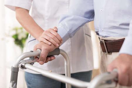 weak: Elder man is too weak to walk without help
