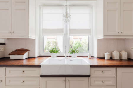 Picture of elegant kitchen furniture with solid wooden worktops