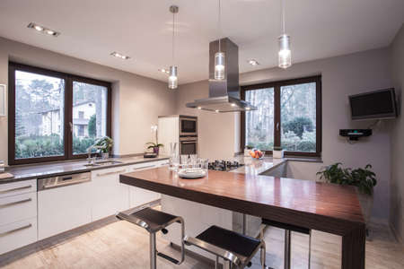 countertop: Light and modern kitchen in the house Stock Photo
