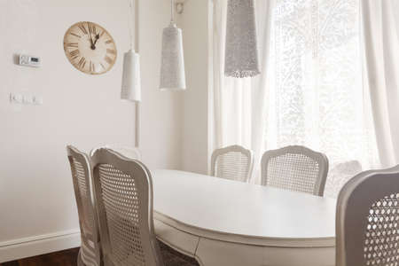 dining table and chairs: Image of white table and chairs in dining room