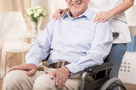 Ill senior is sitting on the wheelchair