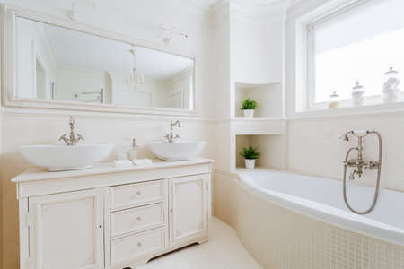 Image of new elegant bathroom with white fittings