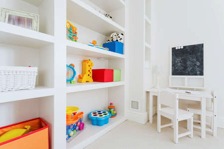 home safety: Zoom of white wooden furnitures in child room Stock Photo