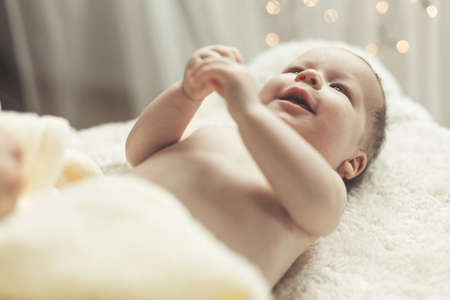 small  picture: Picture of happy smiling baby holding his hands together Stock Photo