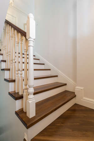 close up: Close up of beautiful solid wooden stairs with railing Stock Photo