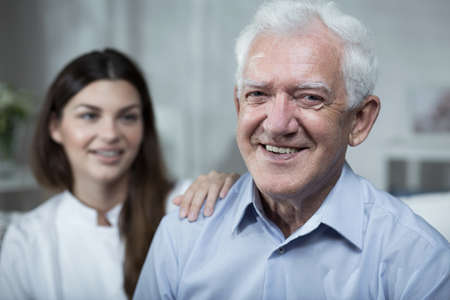 Young nurse is spending time with elder man