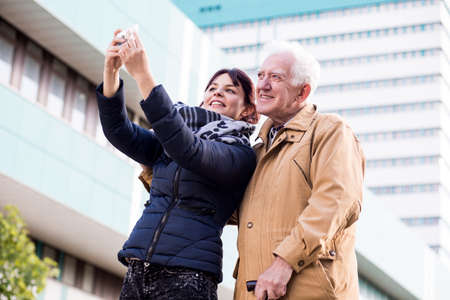 father and daughter: Granddaughter and grandfather doing a selfie picture