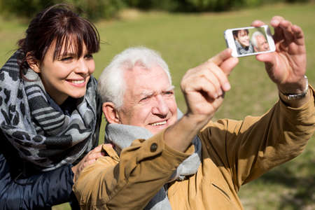 dad and daughter: Senior man and daughter taking picture of themselves