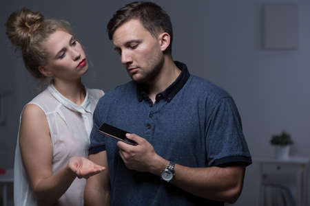 dictate: Woman overpowering man and controlling his phone