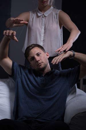 to dominate: Dominate aggressive women treating man like marionette Stock Photo