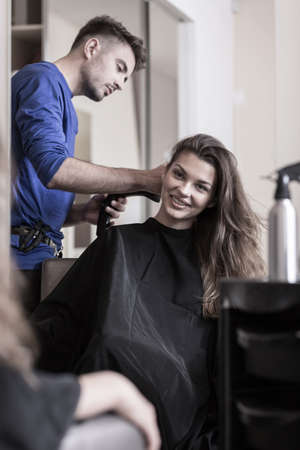 coiffeur: Hairdresser is using new and professional hairdryer