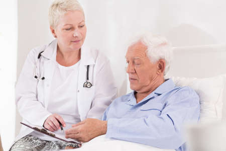 old papers: Old and ill patient has to sign papers