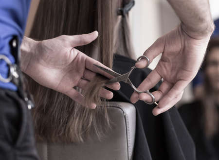 hair style: Hairdresser is using scissors very often in his job