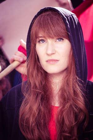 participant: Portrait of female student participant of social revolution