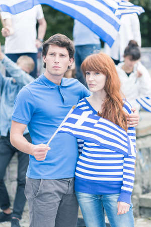 crisis: Image of greek couple on anti government protest