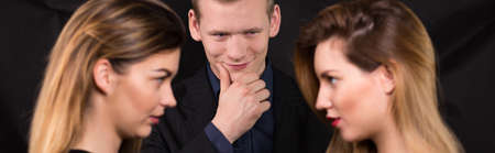 two women and one man: Two beautiful women jealous of one man Stock Photo