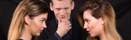 one man: Two beautiful women jealous of one man Stock Photo