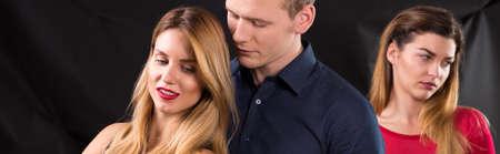 herrin: Sad betrogen Frau und Mann mit mistress Lizenzfreie Bilder