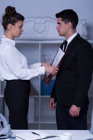 abusing: Image of powerful businesswoman abusing subordinate worker