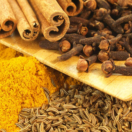 Closeup of cinnamon, cumin,curry, winter spices, square Stock Photo