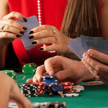 gamblers: Gamblers playing poker game with cards and chips