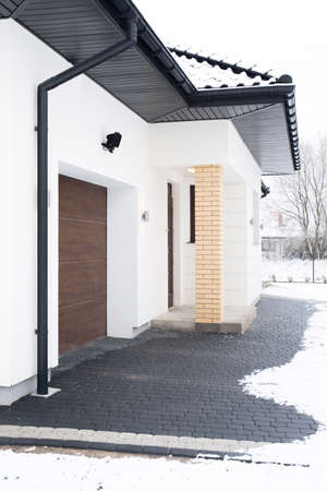 garage on house: Photo of driveway to the garage in big one storey house