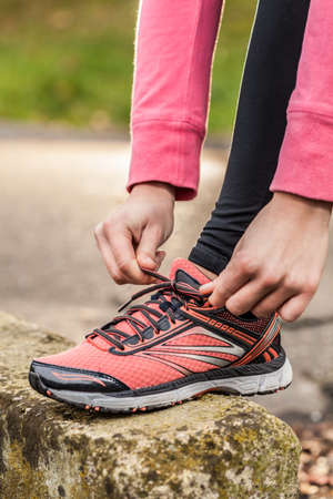 tied girl: Young girl tied shoes before jogging