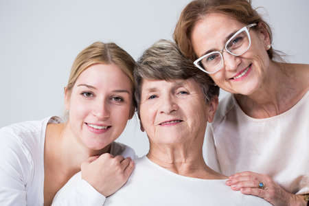 female portrait: Happy multi generational family spending time together