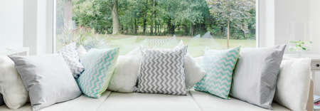 Panorama of cosy window seat with decorative cushions 스톡 콘텐츠