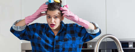 mess: Despair perfect housewife and mess in kitchen Stock Photo