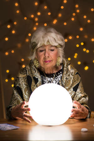 magic ball: Fortune teller seeing future from magic ball