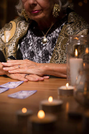 telepathy cards: Tarot card reader in fortune telling salon Stock Photo