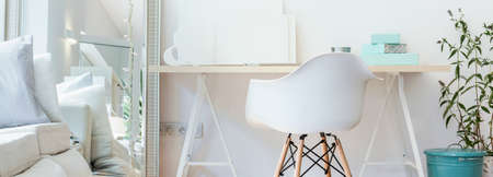 work area: Panorama of contemporary study area with simple wooden desk
