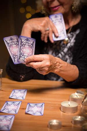 fortuneteller: Fortune teller reading future from tarot cards