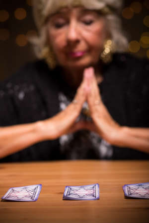 Fortune teller forecasting future during spiritualistic seance