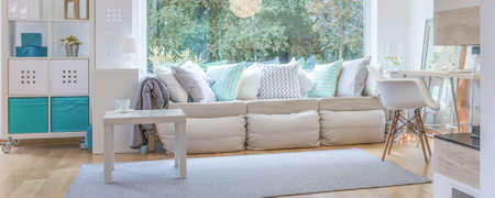 cosy: Panorama of stylish and comfortable window seat in cosy interior Stock Photo