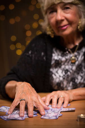 foretell: Female seer using tarot cards to foretell