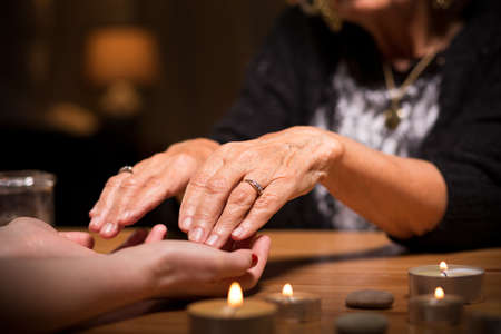 telepathy cards: Close-up of spiritualistic seance in fortune telling salon Stock Photo