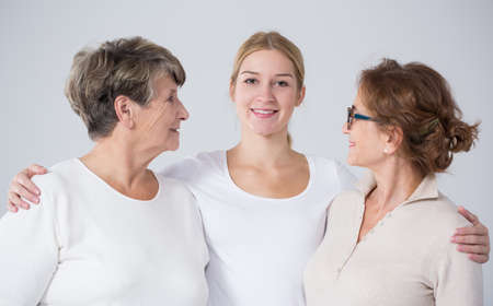 generation: Young woman with mother and grandmother posing to picture