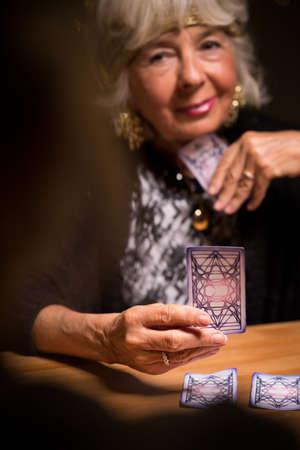 fortuneteller: Female tarot card reader forecasting someone future
