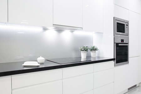 Clean black wheat with decoration in small white kitchen