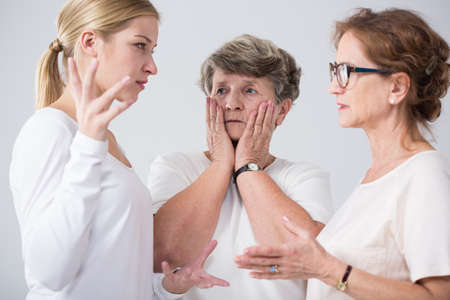 behavioral: Worried family women talking together at home