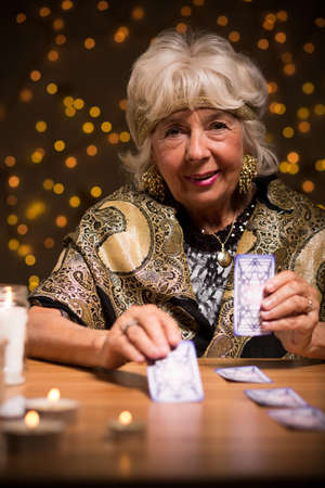 mystique: Fortuneteller using tarot cards to see the future Stock Photo