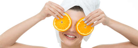 white mask: Banner of a happy woman holding orange slices on face