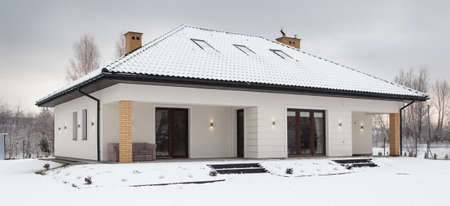 modern home: Photo from the outside of big modern house in winter Stock Photo