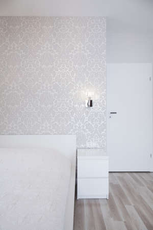 patterned wallpaper: Photo of simple white bedroom with patterned wallpaper