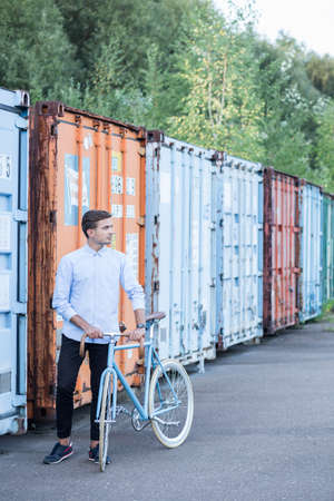 caring for: Businessperson with bike caring for the environment