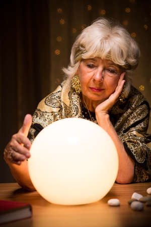 spiritualism: Portrait of fortune teller with crystal ball Stock Photo