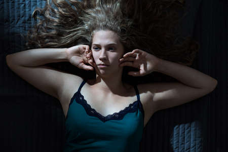 girl bedroom: Image of pensive lady during sleepless night Stock Photo