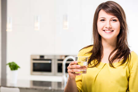 tap: Young beauty woman with glass of water